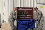 Chief Master Sgt. of the Air Force James A. Roy and Col. Mike Minahan, 380th Air Expeditionary Wng commander, unveil the sign to the Tech. Sgt. Anthony C. Campbell Jr. Memorial EOD Building during a building dedication ceremony June 27, 2010, at an undisclosed base in Southwest Asia. The building was named in honor of Tech. Sgt. Anthony C. Campbell, Jr., an EOD technician from Scott Air Force Base, Ill., who was killed in action by an improvised explosive device while forward deployed to Afghanistan. (U.S. Air Force Photo/ Tech. Sgt. April Wickes)