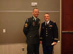 Attached is a photo of 1LT Mark Noziska (right) and I at his commissioning ceremony. I had the honor of mentoring him and receiving his first salute.